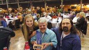 Cross Country Monty receiving Trophy